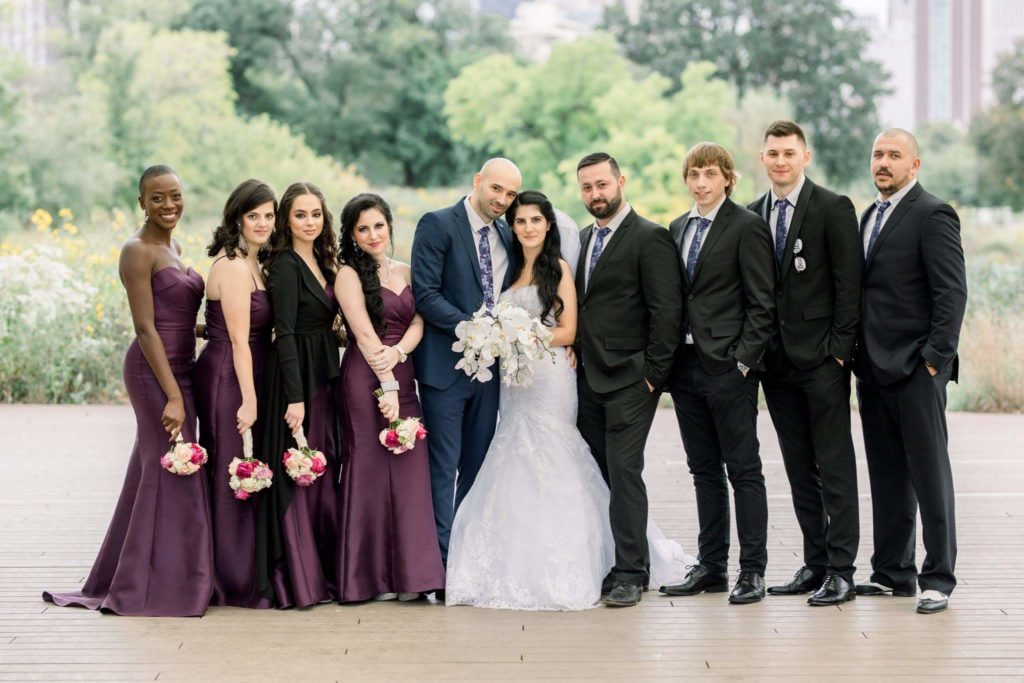 wedding party next to bride and groom